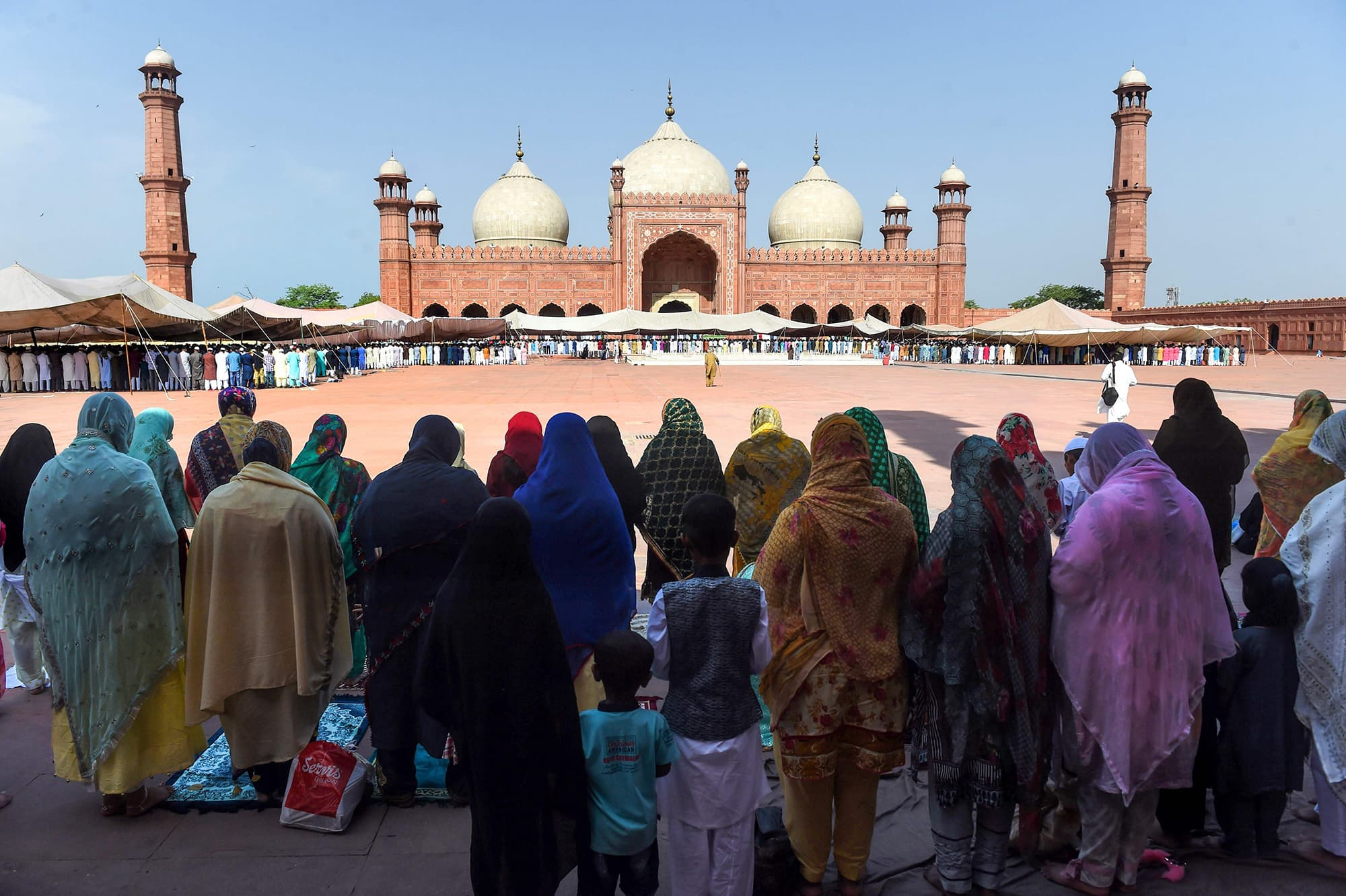 Worshippers offer prayers at the Badshahi Mosque in Lahore. — AFP