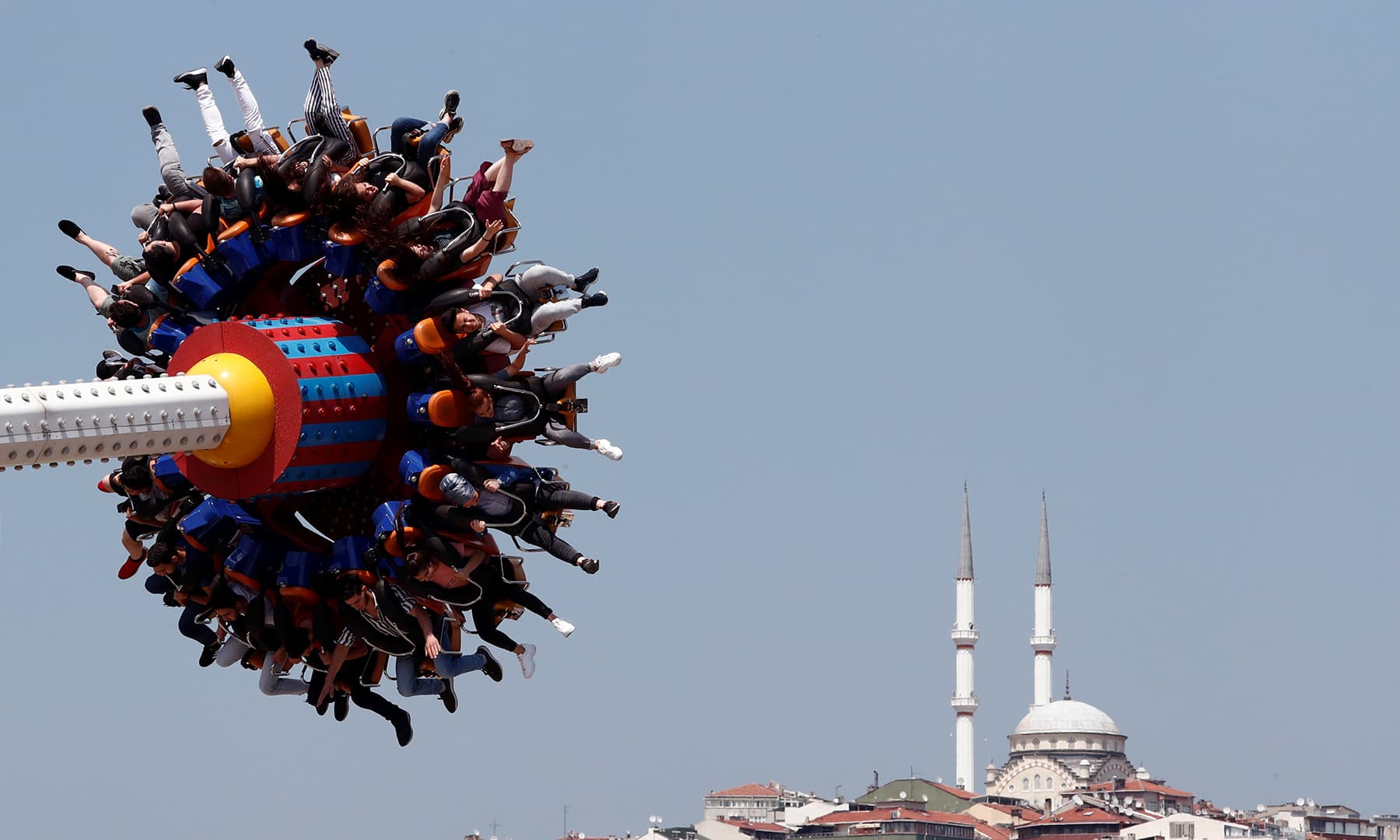 People enjoy a ride in an amusement park as they celebrate the second day of Eidul Fitr in Istanbul, Turkey on June 5. — Reuters