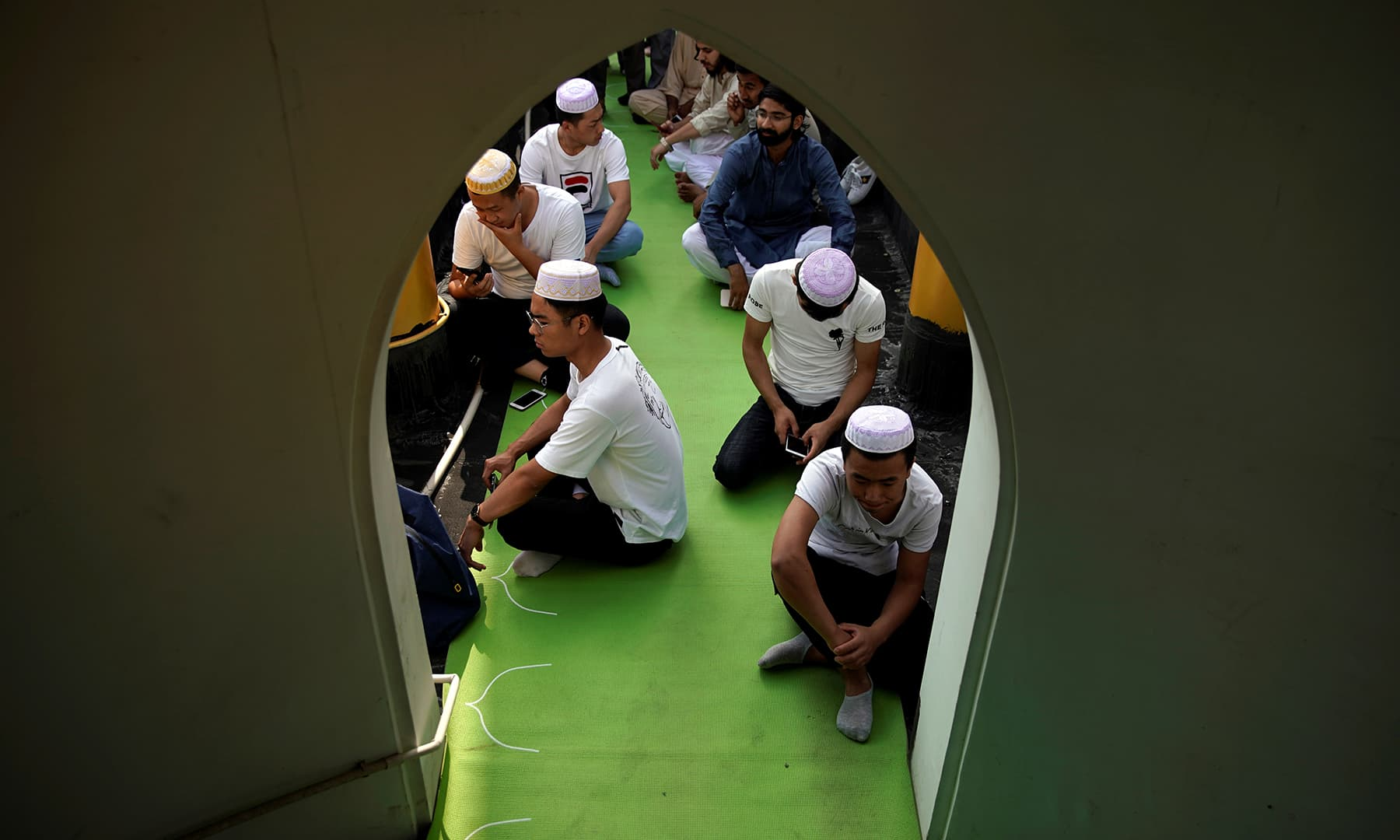 Muslims attend the morning prayers of Eidul Fitr at a mosque in Shanghai, China on June 5. — Reuters