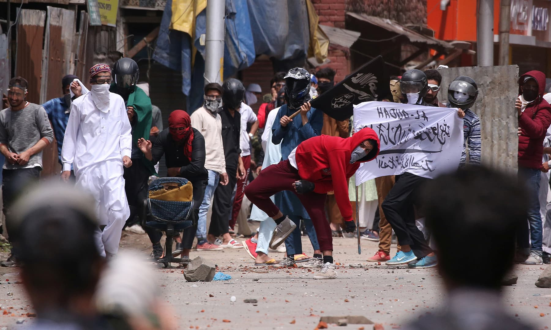 Demonstrators throw stones towards Indian police during clashes after the Eidul Fitr prayers in Srinagar, Indian-occupied Kashmir on June 5. — Reuters.