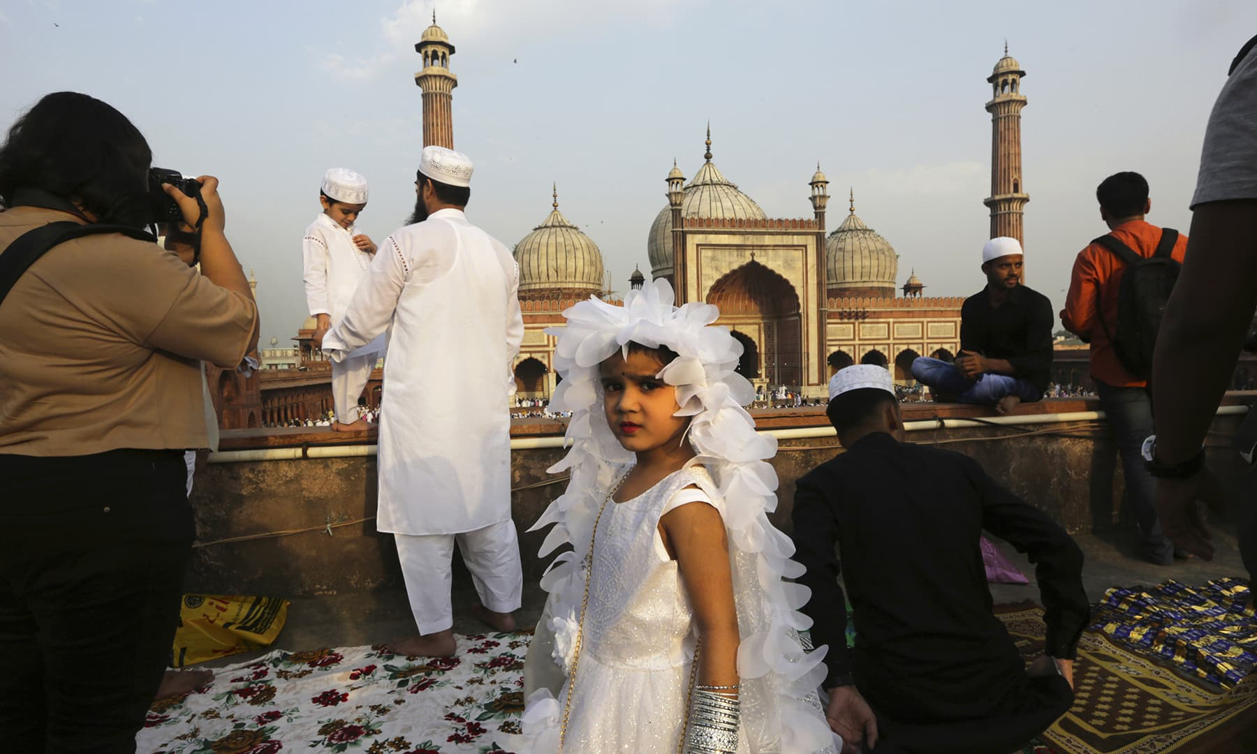 An girl in a celebratory dress arrives with her family to offer Eidul Fitr prayers at the Jama Masjid in New Delhi, India on Wednesday, June 5. — AP