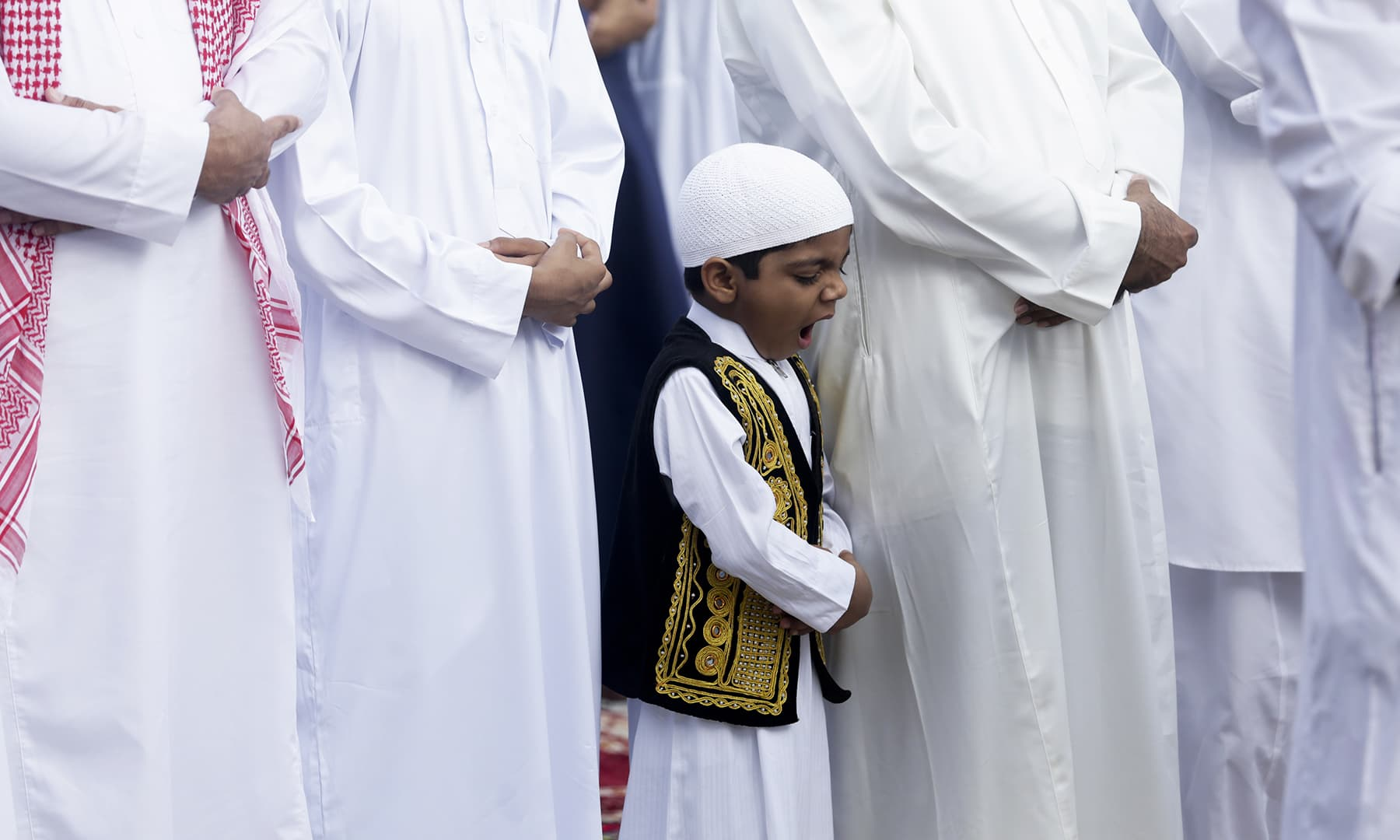 A boy yawns during Eidul Fitr prayers in Panama City on Wednesday, June 5. — AP
