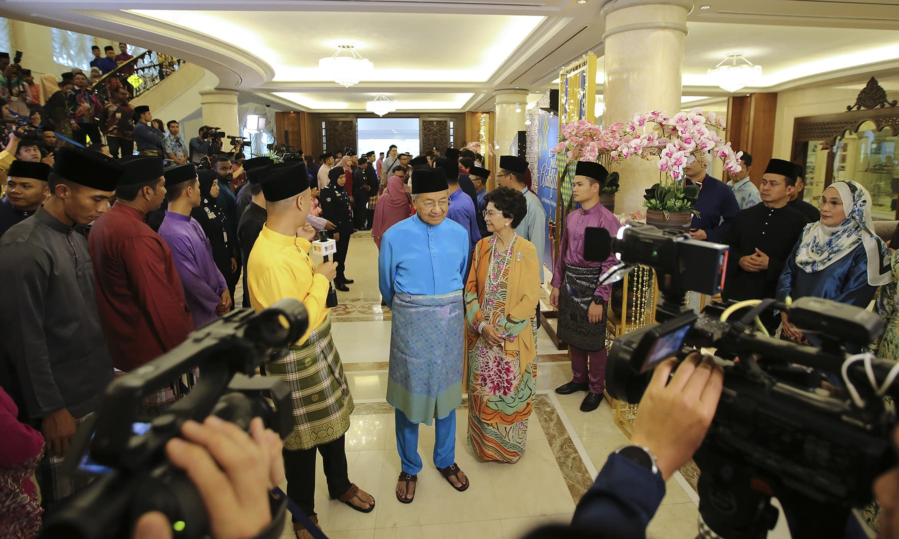 Malaysia Prime Minister Mahathir Mohamad accompanied by his wife Siti Hasmah as they were interviewed by media at Eidul Fitr open house celebration in Putrajaya, Malaysia on Wednesday, June 5. — AP