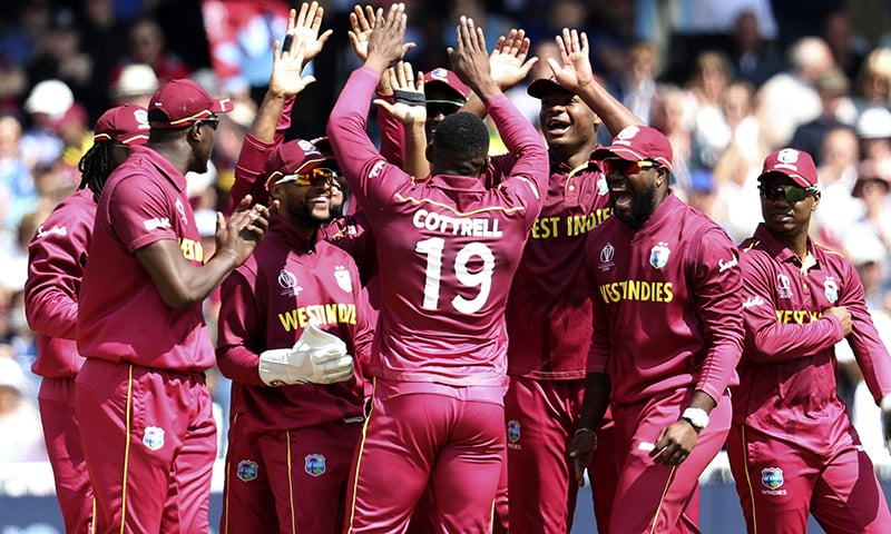 West Indies' Sheldon Cottrell (C) celebrates with teammates after dismissing Australia's Glenn Maxwell during the Cricket World Cup match between Australia and West Indies at Trent Bridge in Nottingham on June 6. — AP