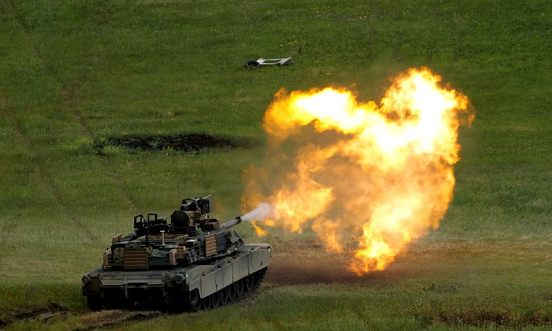 "In this file photo, a US M1A2 ""Abrams"" tank fires during US- led joint military exercise ""Noble Partner 2016"" in Vaziani, Georgia, May 24, 2016. — Reuters"