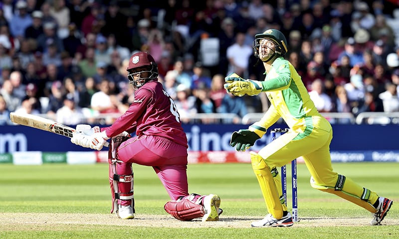 Australia's wicketkeeper Alex Carey, right, reacts after West Indies' Shai Hope, left, plays a shot. — AP