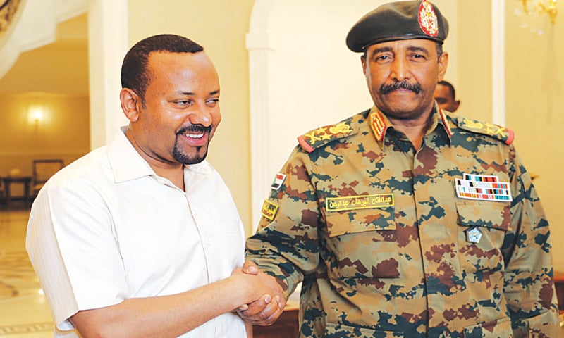 Khartoum: Ethiopian Prime Minister Abiy Ahmed (left) meets the head Of Sudan's military council, Lieutenant General Abdel Fattah Al-Burhan Abdelrahman, at the airport on Friday.—Reuters