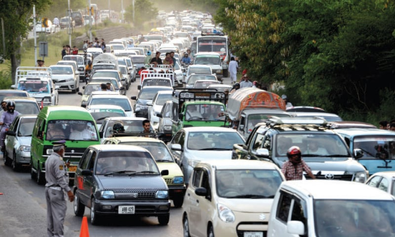 A long line of vehicles seen on Murree Road near Lake View Park in Islamabad on Friday. Many families are heading towards Murree to spend their holidays. — White Star