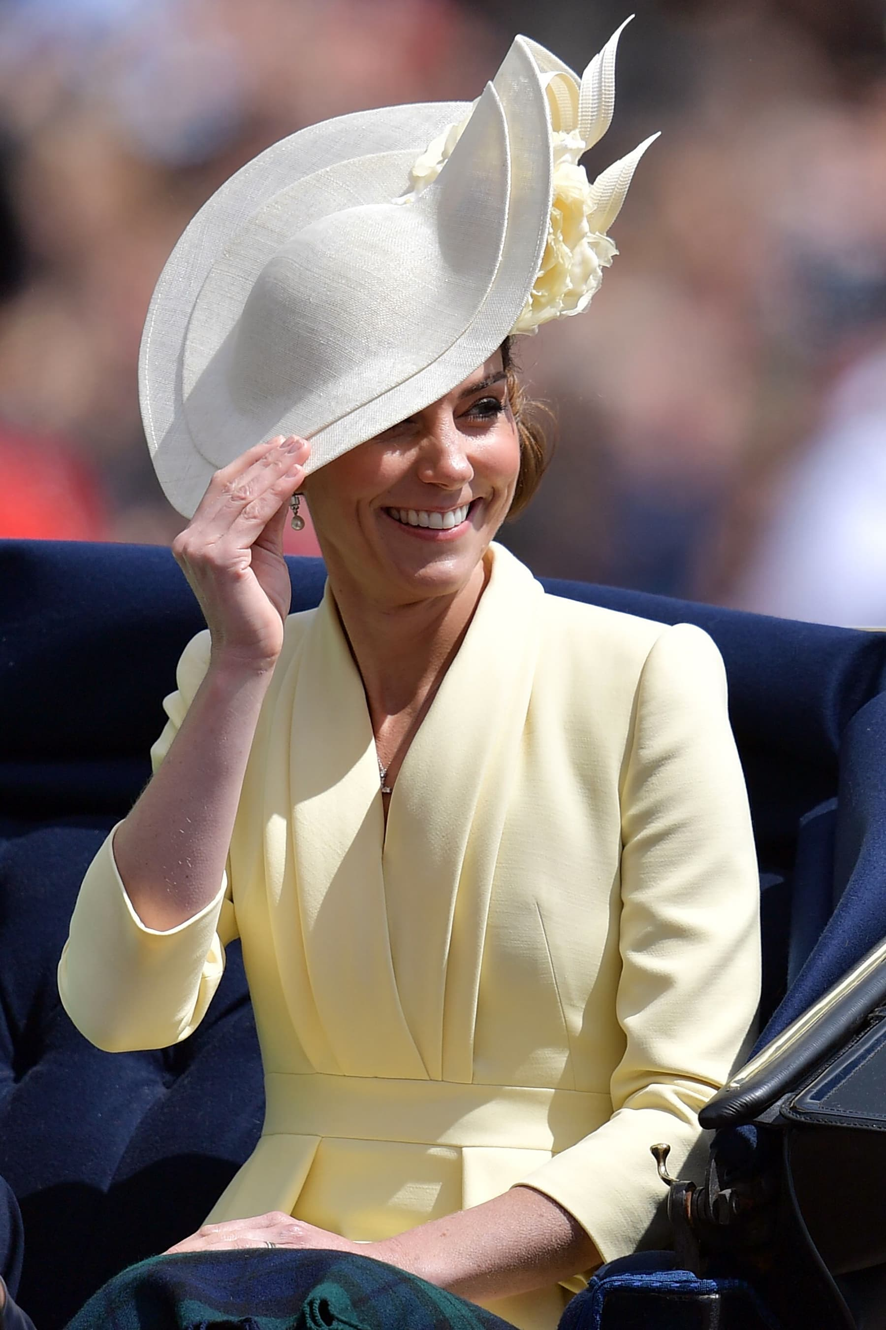Britain's Catherine, Duchess of Cambridge smiles as she returns to Buckingham Palace. — AFP