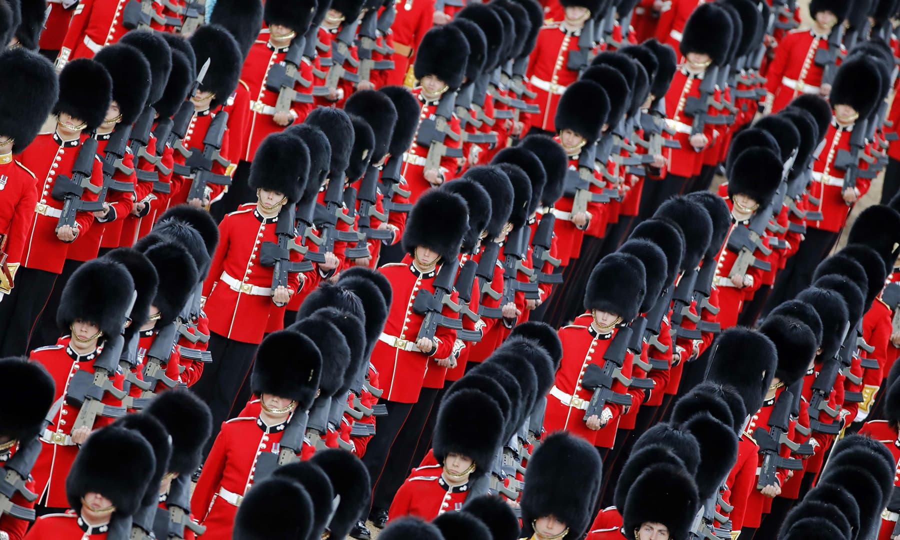 Members of the Grenadier Guards perform. — AFP