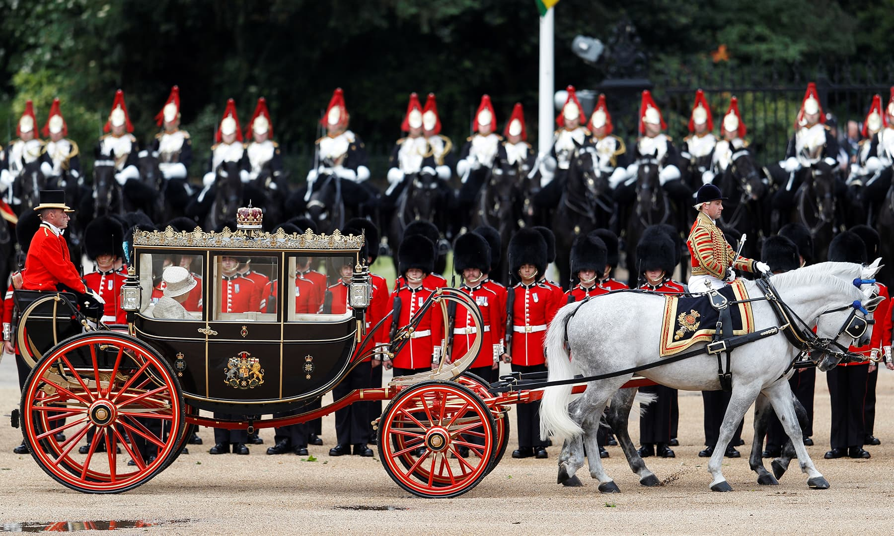 Britain's Queen Elizabeth pictured in her horse-drawn carriage as she participates in the Trooping the Colour parade in central London, Britain. — AFP