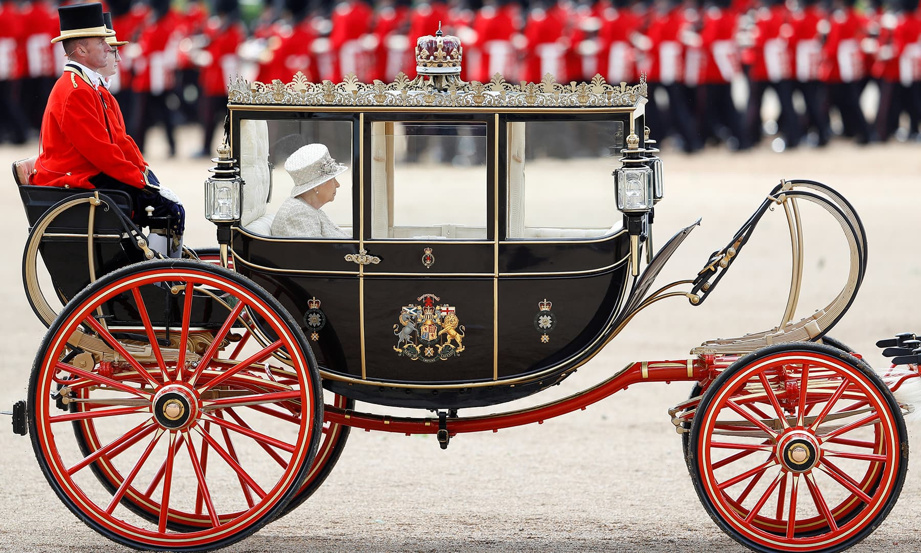 A full view and close up of the Queen's horse-drawn carriage. —Reuters