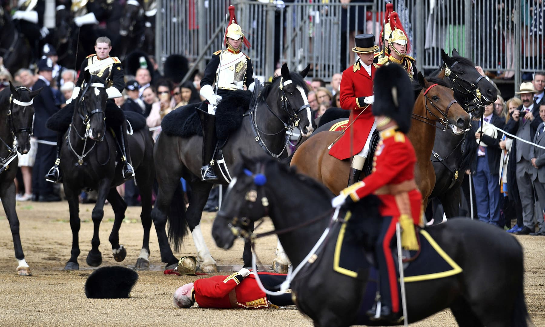 A soldier falls from his horse during the annual Trooping the Colour Ceremony in London. — AP