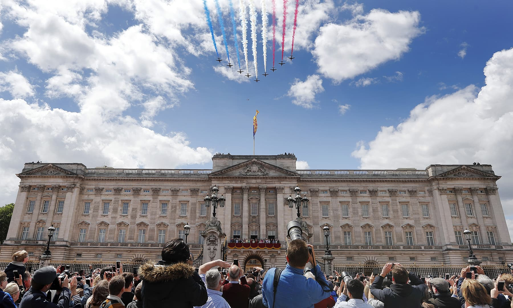 Airplanes of the Red Arrows fly over Buckingham Palace. — AP