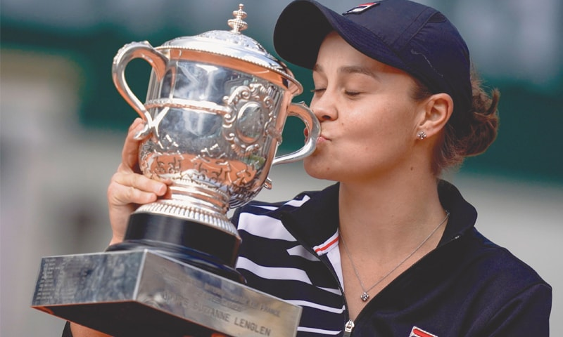 PARIS: Australia's Ashleigh Barty kisses the trophy after winning the French Open final against Marketa Vondrousova of the Czech Republic on Saturday. — AFP