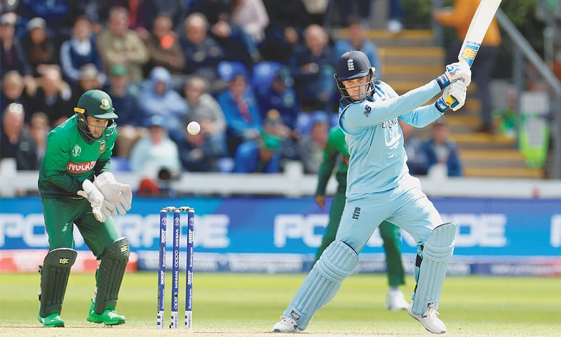 CARDIFF: England opener Jason Roy drives forcefully as Bangladesh wicket-keeper Mushfiqur Rahim looks on during their match at Sophia Gardens  on Saturday.—Reuters
