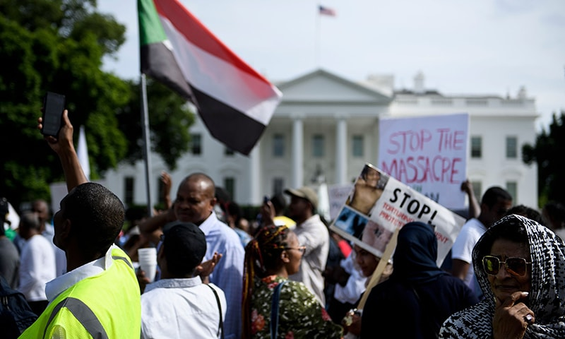 People protest against Monday's deadly military raid on a nonviolent sit-in in Khartoum, Sudan, outside of the White House on June 8, 2019 in Washington, DC. — AFP