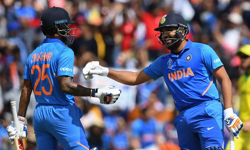 India's Rohit Sharma (R) congratulates India's Shikhar Dhawan after a boundary during the 2019 Cricket World Cup group stage match between India and Australia at The Oval. — AFP