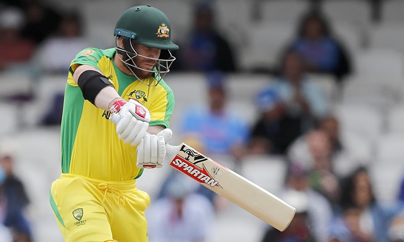 Australia's David Warner return a shot during the Cricket World Cup match between India and Australia at the Oval. — AP