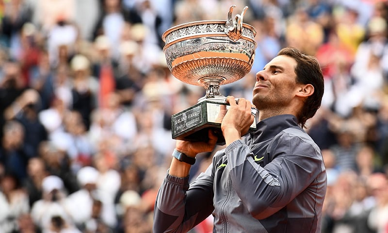 History man Nadal sweeps to 12th French Open and 18th Grand Slam title