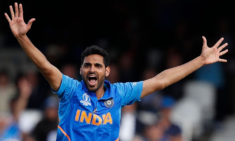 India's Bhuvneshwar Kumar makes a succesful appeal for a leg before wicket (LBW) decision against  Australia's Steve Smith during the 2019 Cricket World Cup group stage match between India and Australia. — AFP