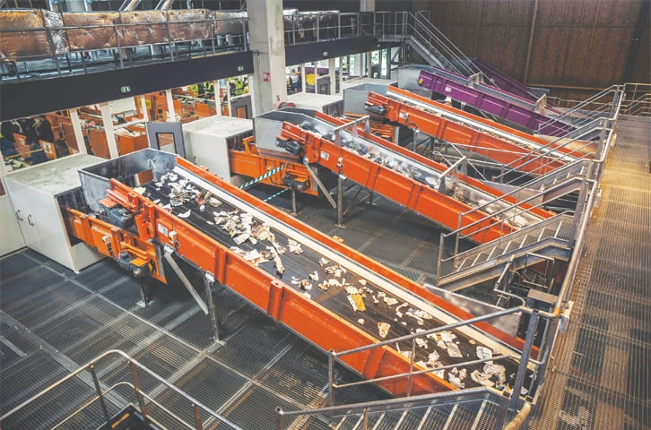 Conveyor belts carry away garbage at the Syctom sorting center on the day of its inauguration, in the 17th district of Paris, France, last week. A new sorting center has just opened its doors at a time when the public authorities want to strengthen sorting in large cities, less systematic than in rural areas. This sorting center, with a capacity of 45,000 tons, will be able to recycle the waste of 900,000 inhabitants of Paris and neighboring municipalities.—AFP