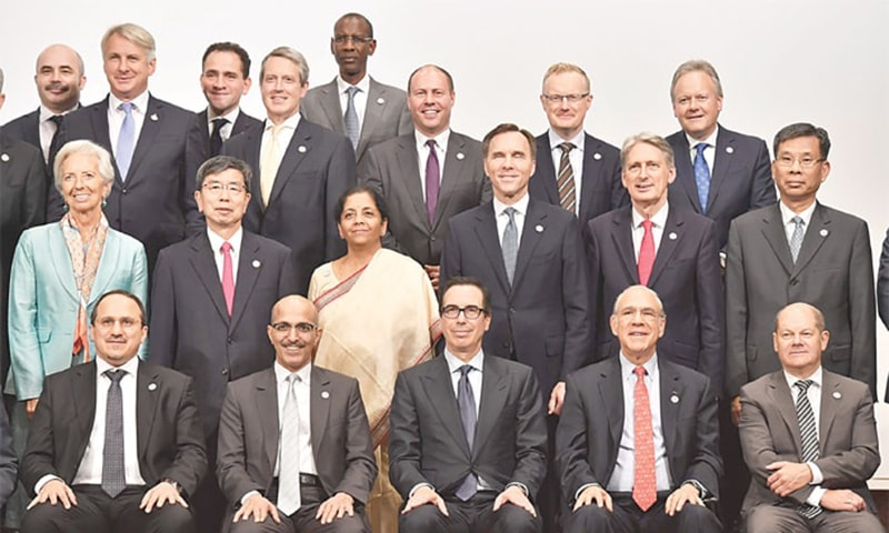 Fukuoka: IMF managing director Christine Lagarde (second row left), US Treasury Secretary Steven Mnuchin (front centre) and China's Finance Minister Liu Kun (second row right) pose in a photo session at the G20 finance ministers meeting on Sunday. — AFP