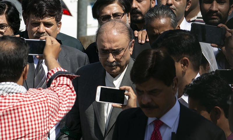Former president and PPP co-chairman Asif Ali Zardari, center, leaves the IHC building, in Islamabad on Monday. — AP