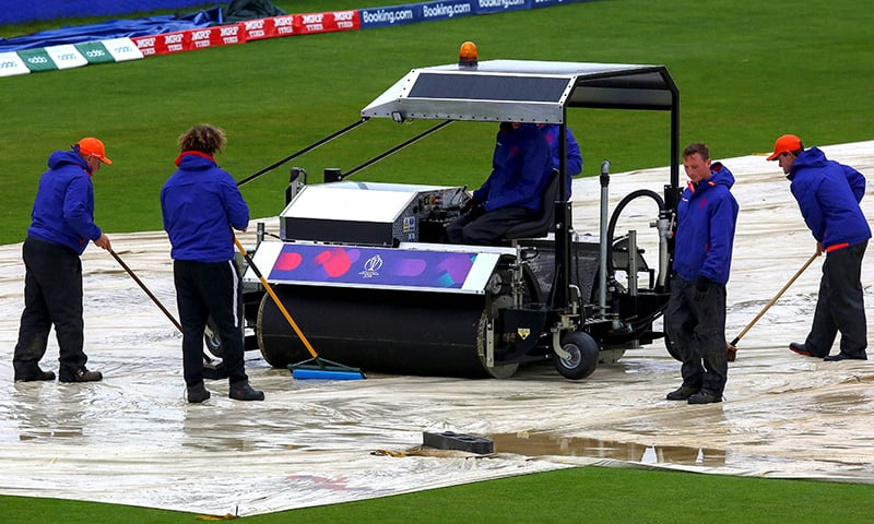 Groundkeepers brush water from the covers as rain delays the start of play ahead of the 2019 Cricket World Cup group stage match between Bangladesh and Sri Lanka at Bristol County Ground in Bristol, southwest England on June 11. — AFP