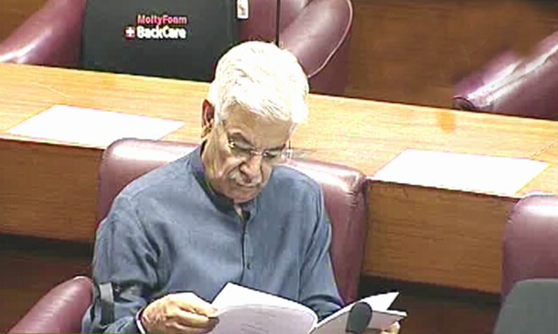PML-N parliamentary leader in the National Assembly Khawaja Asif reads a document during the National Assembly budget session. — DawnNewsTV screengrab
