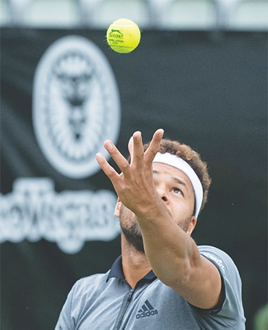STUTTGART: Jo-Wilfried Tsonga of France serves to Germany's Mischa Zverev during their first-round match at the Stuttgart Open.—AFP