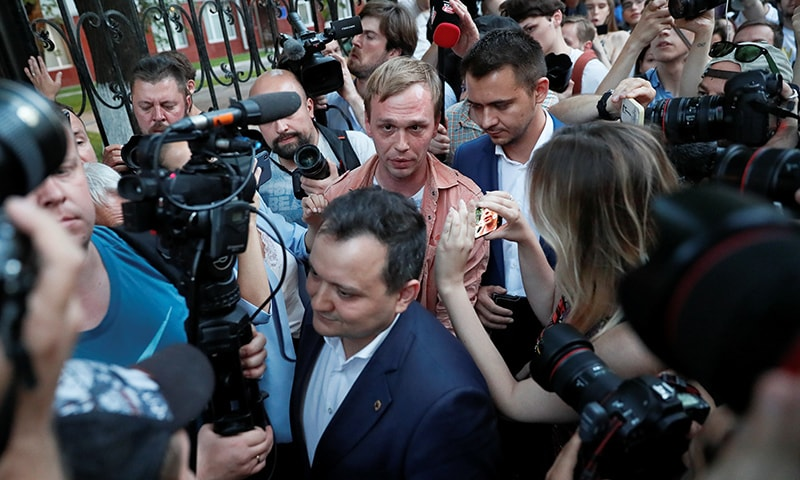 Russian journalist Ivan Golunov (C), who was freed from house arrest after police abruptly dropped drugs charges against him, reacts during a meeting with the media and his supporters outside the office of criminal investigations in Moscow, Russia on June 11. — Reuters