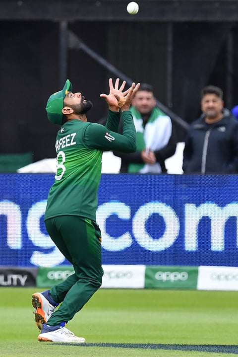 Mohammad Hafeez takes a catch to dismiss Aaron Finch. ─ AFP