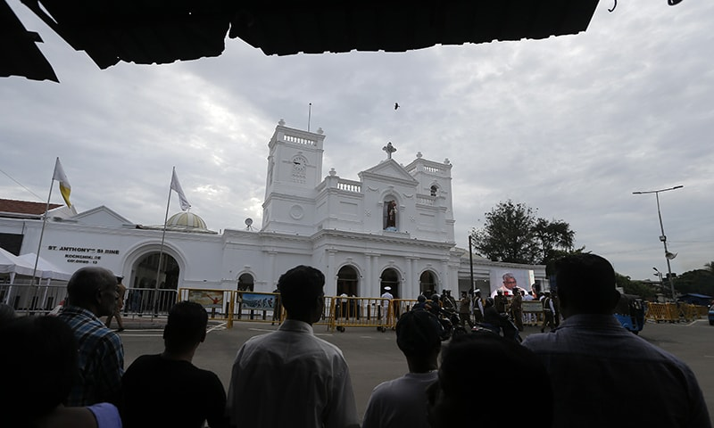 Sri Lankans look at the reconstructed St Anthony's church, one of the sites that came under attack, in Colombo, Sri Lanka, Wednesday, June 12. — AP