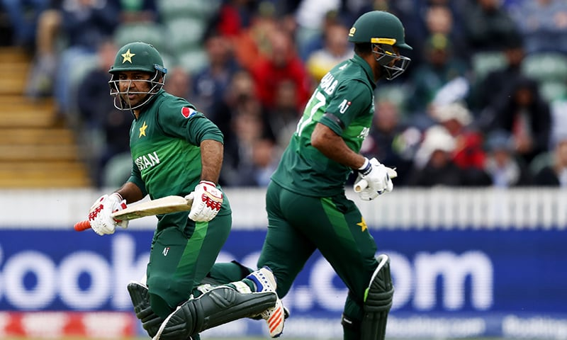 Skipper Sarfaraz Ahmed (L) and Wahab Riaz grab some quick runs off Australian Nathan Coulter-Nile's bowling during the Cricket World Cup match in Taunton. ─ AP