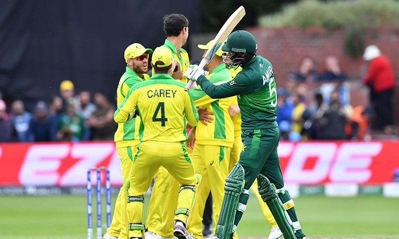 Amir departs as Australia tighten grip on the match. — AFP