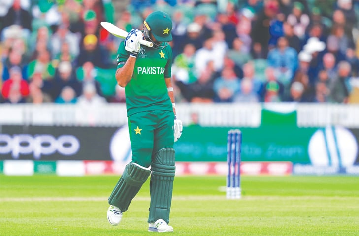PAKISTAN'S Wahab Riaz walks off after being dismissed on Wednesday.—Reuters