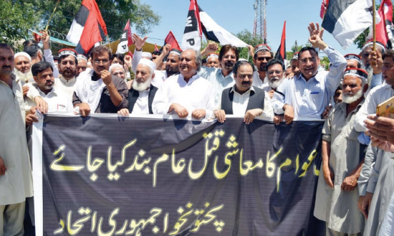 QWP leader Sikandar Sherpao leads a rally in Peshawar on Wednesday against federal budget. — Online