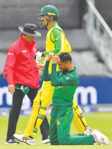 TAUNTON (England): Mohammad Amir celebrates his fifth wicket during the World Cup match against Australia on Wednesday. Amir dragged Pakistan back into the game with career-best figures of five for 30 in 10 overs, but Australia still managed to post a challenging score of 307. The target ultimately proved beyond Pakistan, who lost by 41 runs despite rearguard action from Sarfraz Ahmed and Wahab Riaz.—AFP