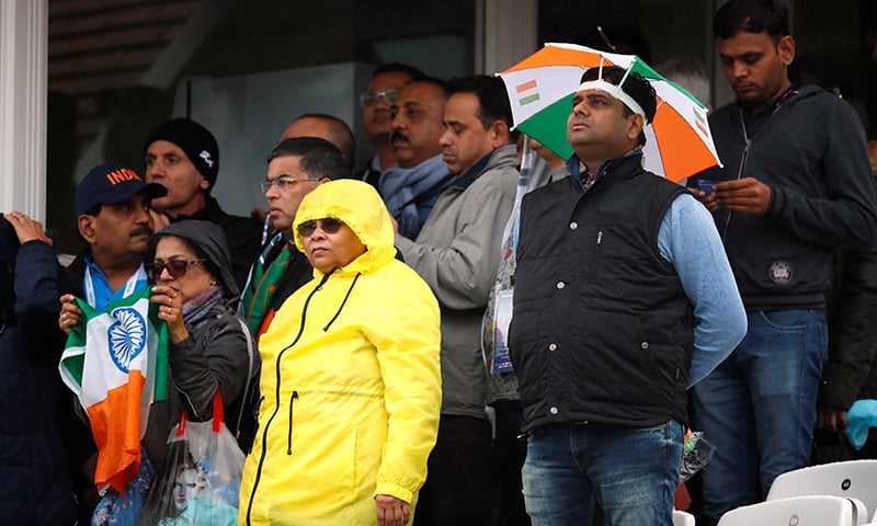 Indian fans at Trent Bridge wait for World Cup fixture between India and New Zealand to begin,. The match has been delayed due to rain. — Reuters
