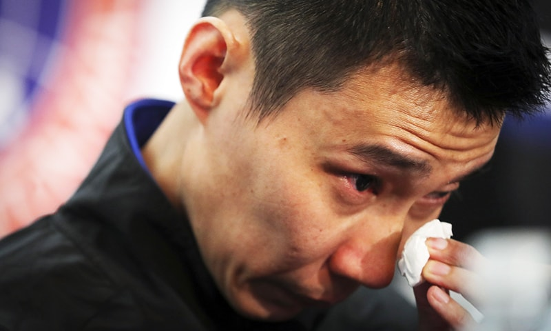 Malaysian badminton player Lee Chong Wei wipes his tears during a press conference in Putrajaya, Malaysia, June 13, 2019. — AP