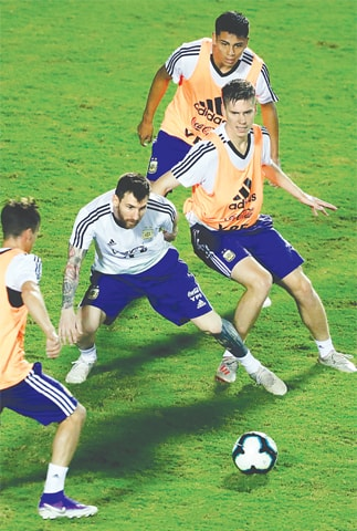 SALVADOR: Argentina's Lionel Messi (second L) and Juan Foyth (R) attend a training session at Manoel Barradas Stadium on Thursday as they prepare for the upcoming Copa America.—AFP