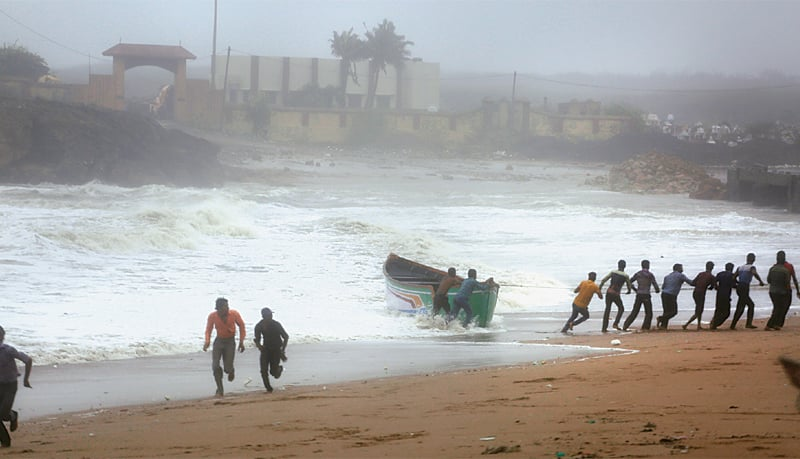 Winds, rain batter western India as cyclone veers away
