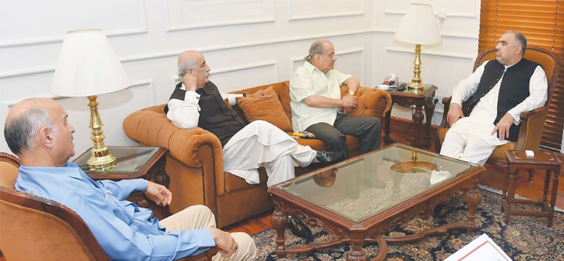 Opposition members Mian Raza Rabbani, Khursheed Shah and Mushaid Hussain Sayed speak to National Assembly Speaker Asad Qaiser at the latter's residence on Thursday.—White Star