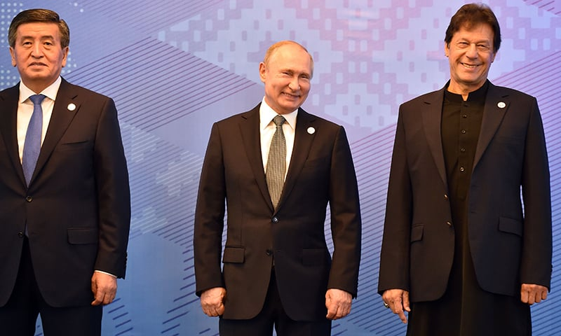 From L: Kyrgyz President Sooronbai Jeenbekov, Russian President Vladimir Putin and Prime Minister Imran Khan pose for a photo prior to a meeting of the Shanghai Cooperation Organisation Council of Heads of State in Bishkek. — AFP
