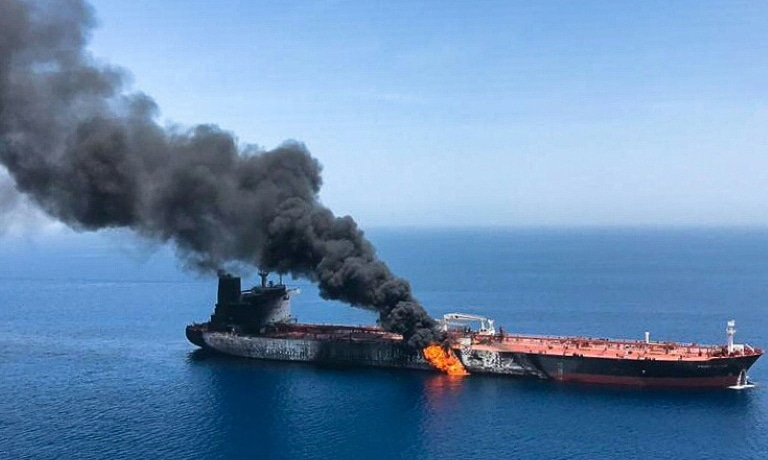 A picture from Iranian News Agency ISNA on June 13 reportedly shows fire and smoke billowing from the Norwegian-owned Front Altair tanker, one of two vessels hit by suspected attacks in the waters of the Gulf of Oman. — AFP