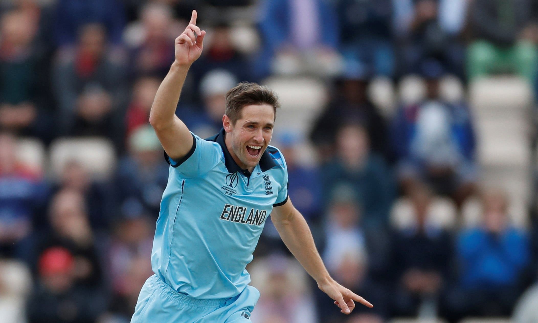 Woakes celebrates taking the wicket of West Indies Evin Lewis. — Reuters