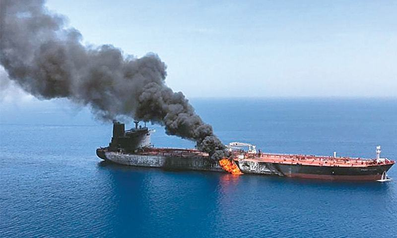This picture provided by Iranian news agency ISNA on Thursday shows fire and smoke billowing from a tanker said to have been attacked in the Gulf of Oman. — AFP