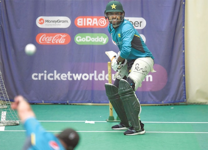 MANCHESTER: Pakistan's Babar Azam bats during an indoor nets session at Old Trafford on Friday.—AFP