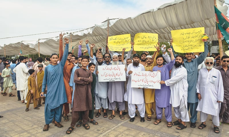 PTI supporters and residents of NA247 protest outside the KWSB head office on Friday.—White Star